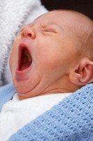 yawning-baby-boy-portrait